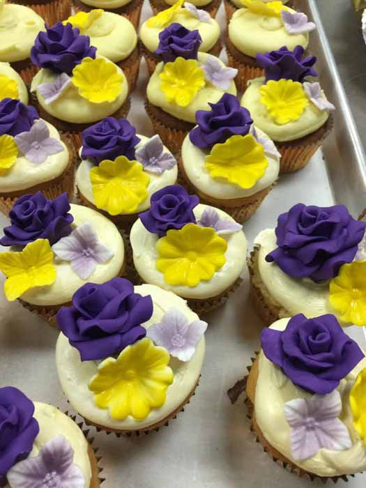 Cupcakes with yellow and purple flowers