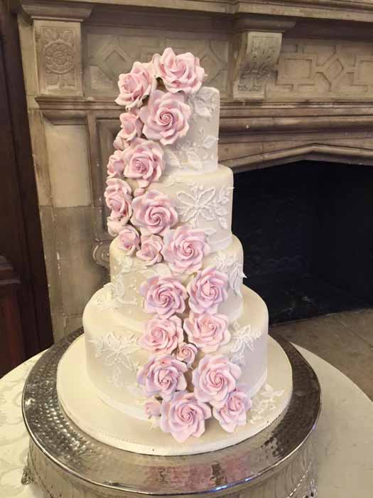 4-tiered white cake with pink flowers