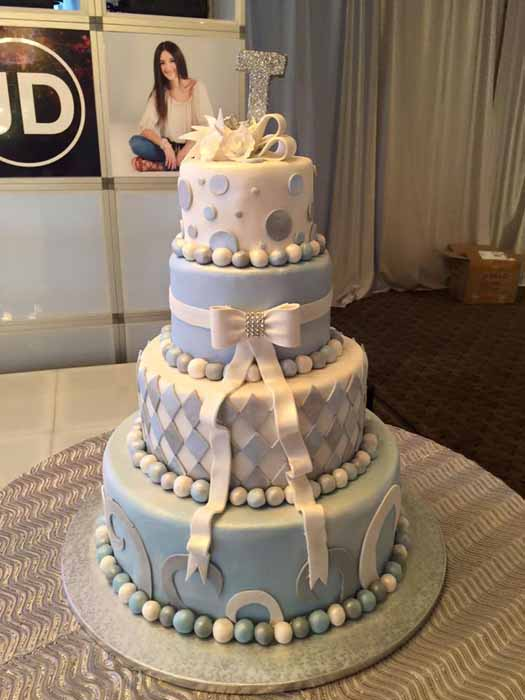 4-tiered light blue and white cake