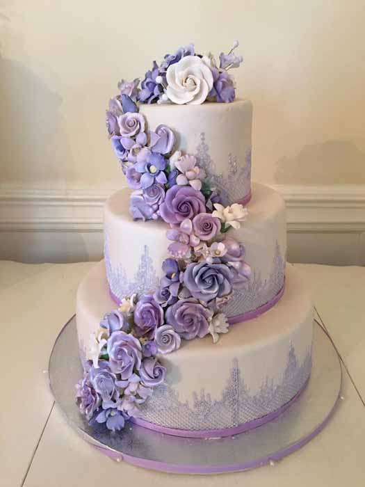 3-tiered light purple cake with flowers