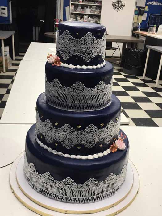 4-tiered dark cake with lace