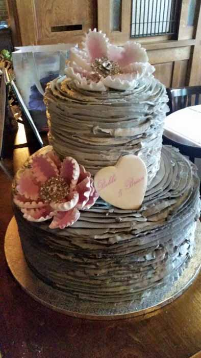 2-tiered grey wedding cake with pink flowers