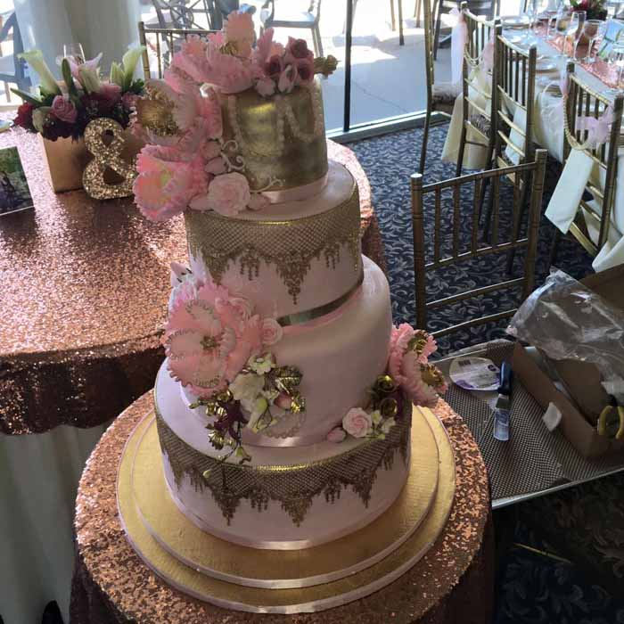 pink and gold 4-tiered cake