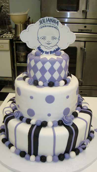 Purple, white and black baby's first birthday