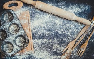 Floured table with baking supplies