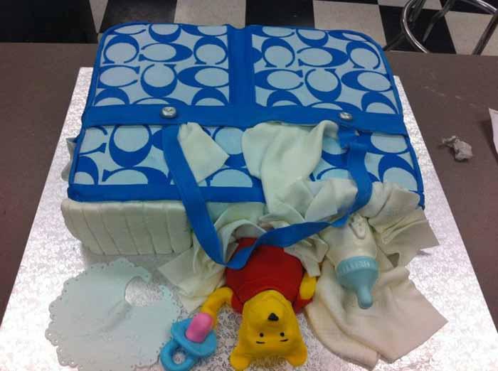 designer baby bag with bear cake