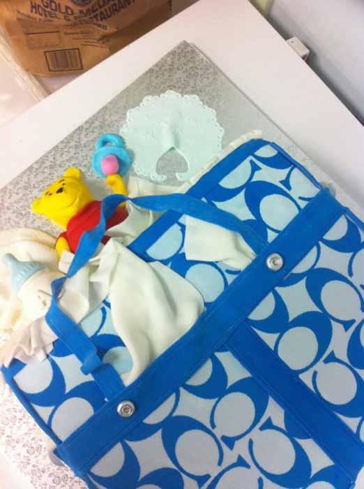 designer baby bag cake