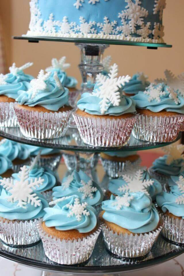Stack of blue Cupcakes with White Snowflakes