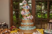 6-tiered lopsided cake - gold and light blue