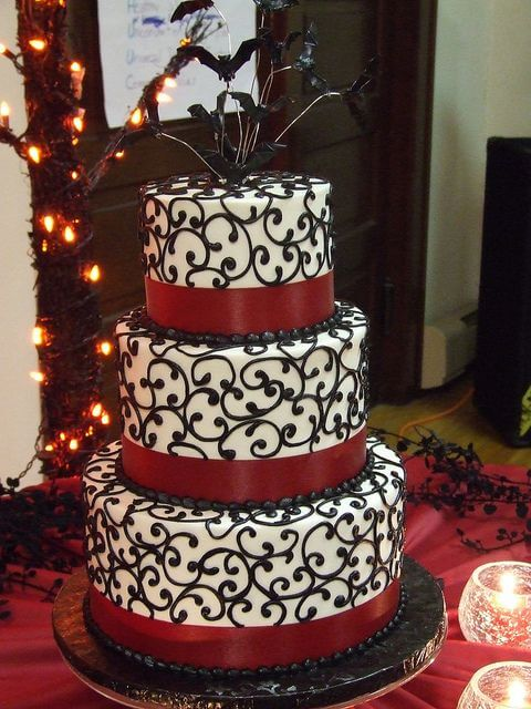 3-tiered white, black and red cake