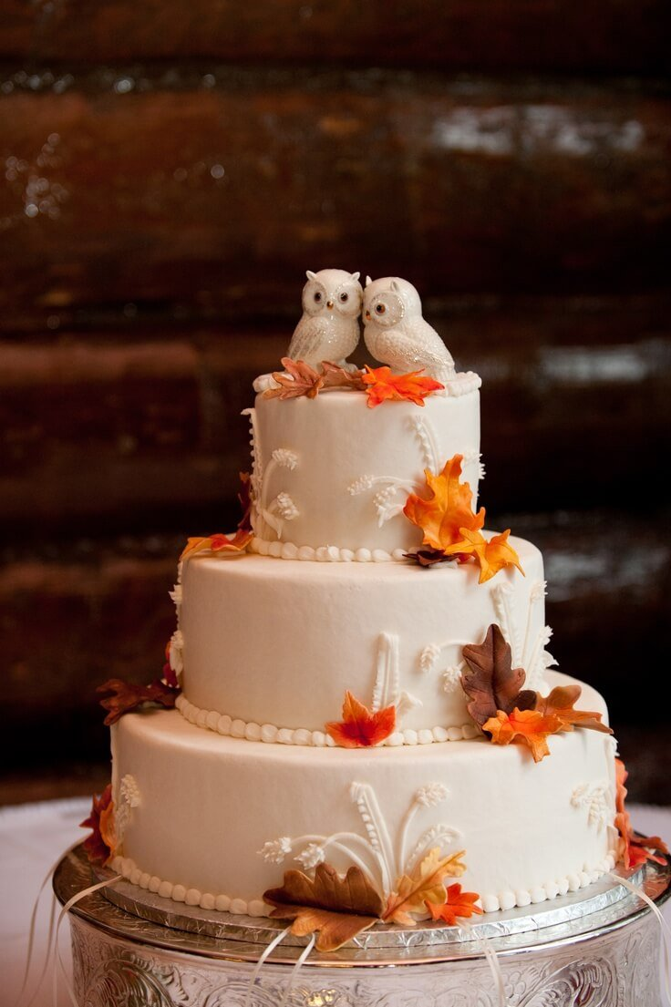 3-tiered cake with 2 owls on top and fall colored leaves