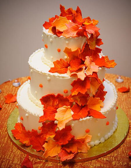 3-tiered white cake with orange leaves