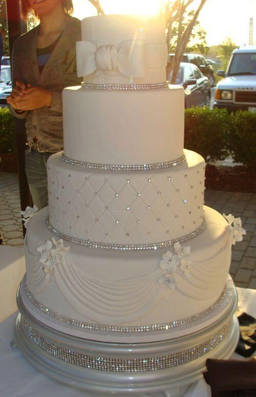 4-tiered white and silver cake
