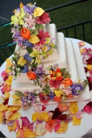 4-tiered white cake with colorful flowers