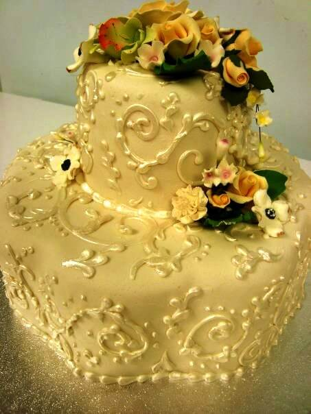two-tiered cake with flowers