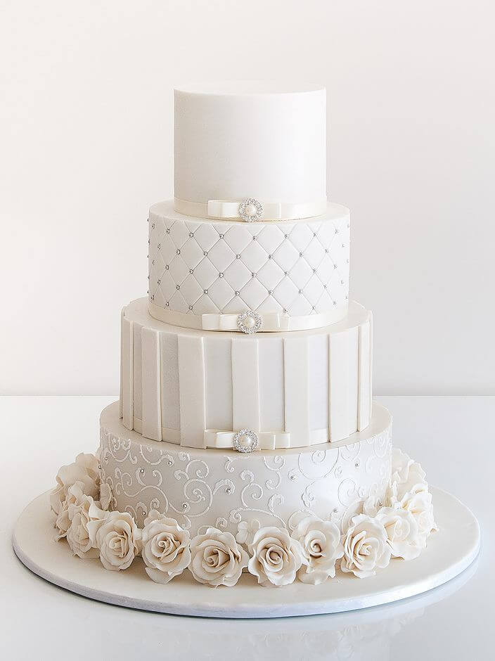 4-tiered all white cake with flowers