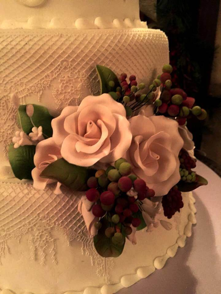 close up of flowers on wedding cake