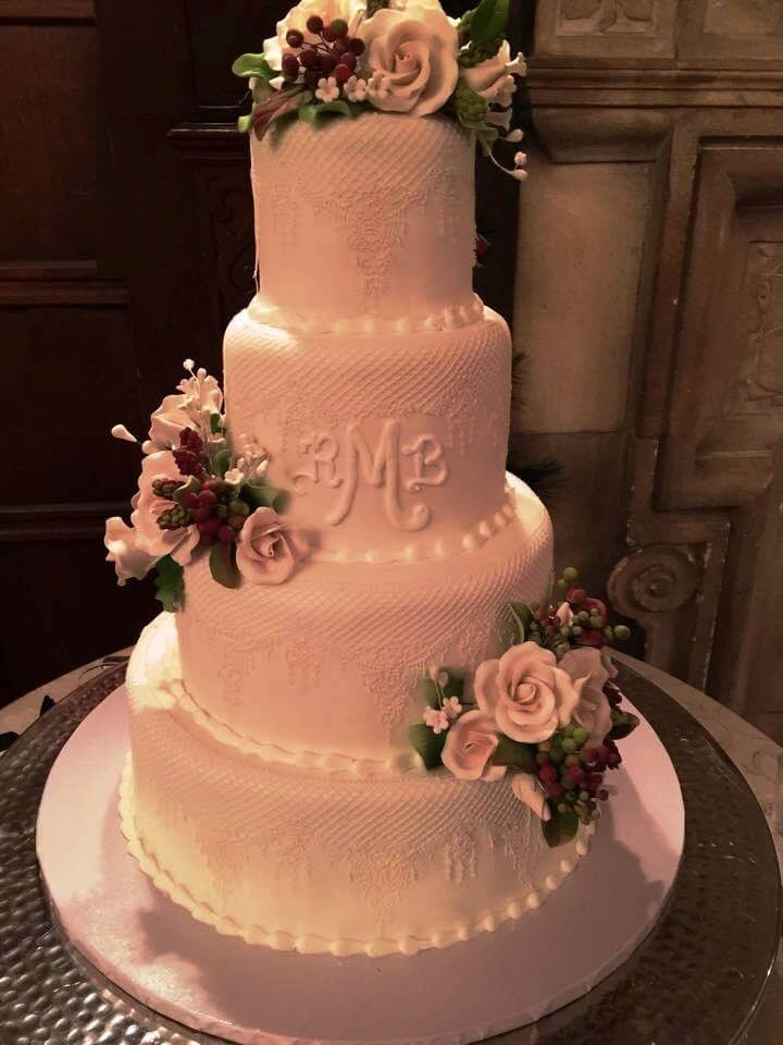4-tiered wedding cake with flowers