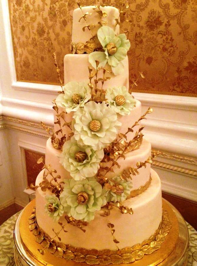 5-tiered cake with light green flowers