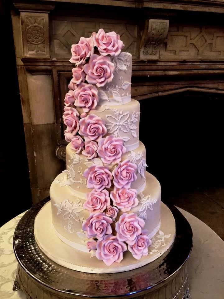 mauve 4-tiered cake with pink flowers