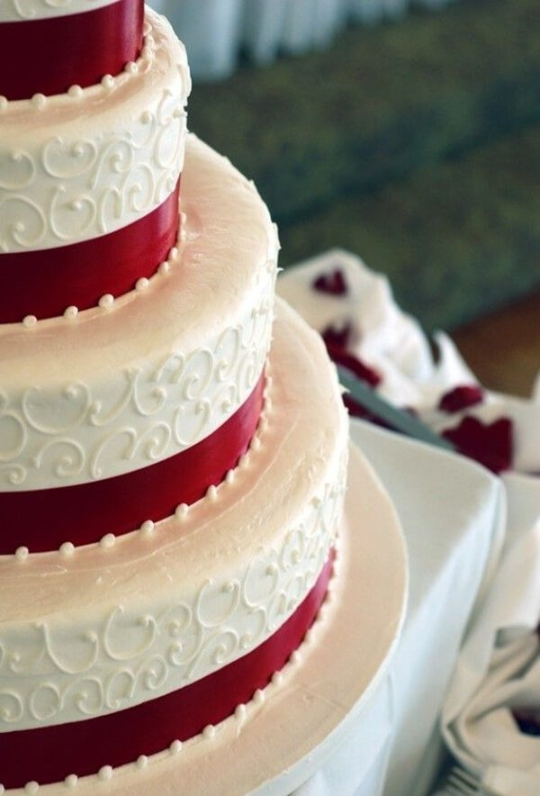 close up of white and red christmas cake
