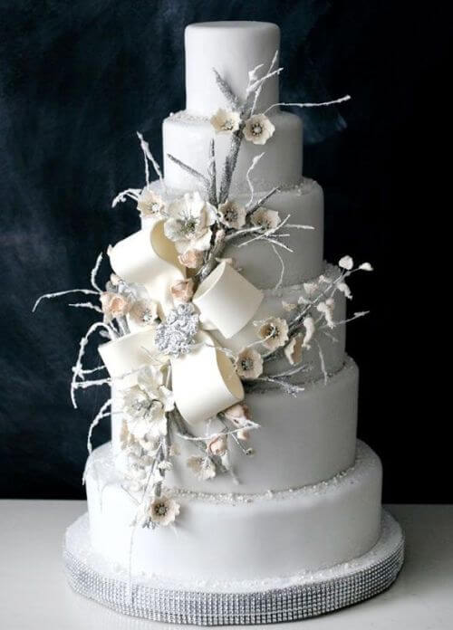 6-tiered all white cake with flowers