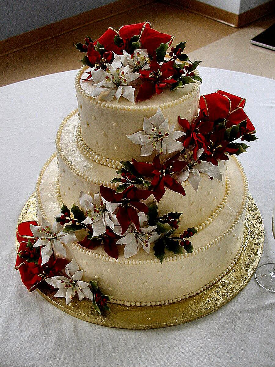 3-tiered cake with white and red flowers