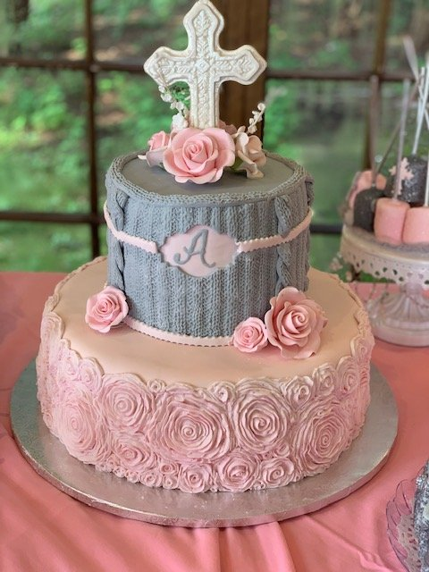 2-tiered pink and grey cake with cross on top
