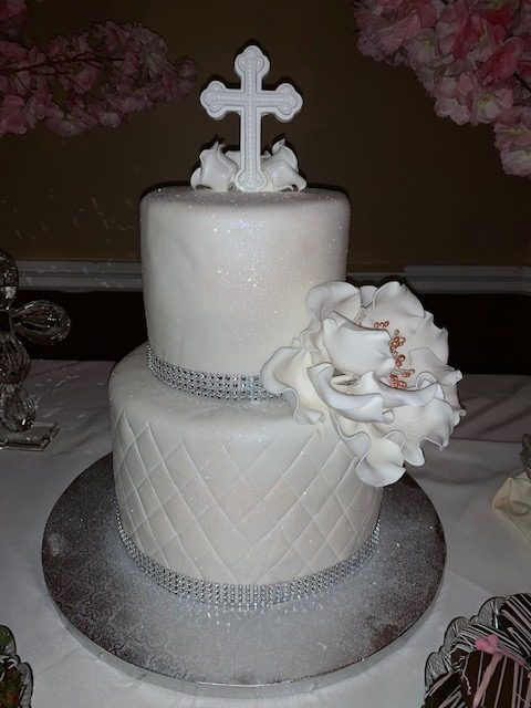 White bling cake with cross on top