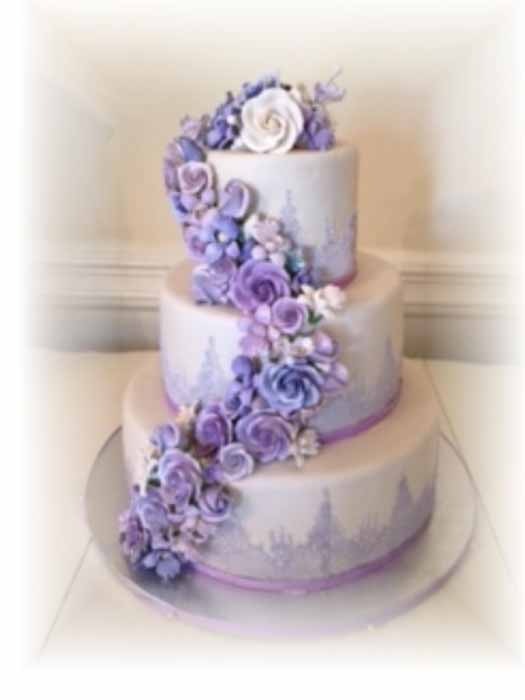 3 tiered cake with purple flowers