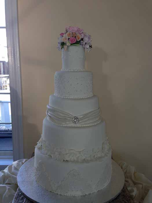 6-tiered cake with pink flowers
