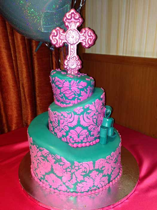Green and pink cake with cross on top