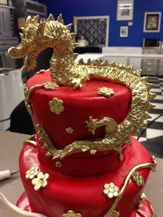 Up close of red dragon cake