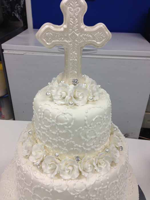All white cake with cross on top
