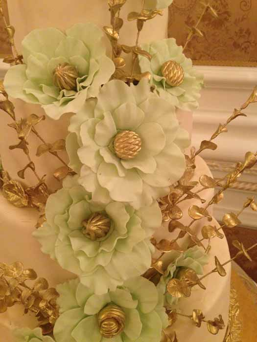 close up of light green flowers on cake