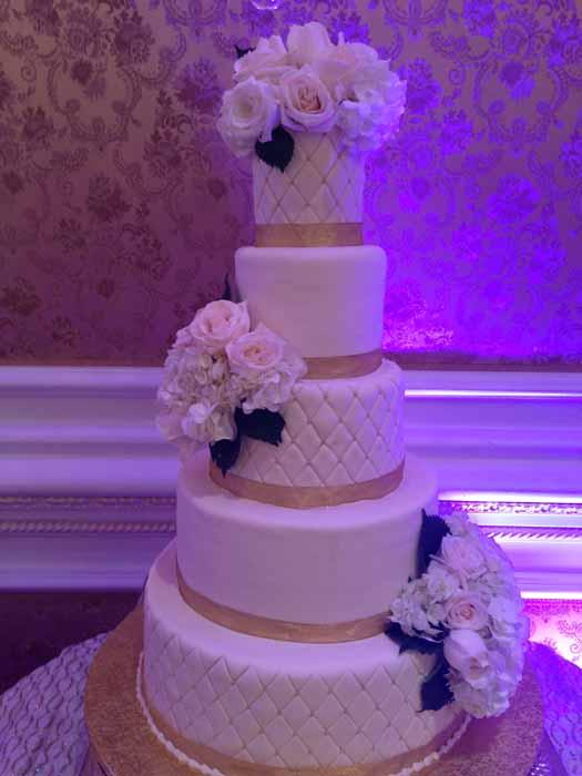 5-tiered white wedding cake