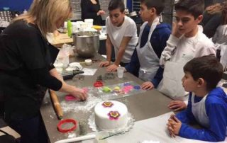 4 boys watching a woman leading a class | Cake Decorating Decorating Tools Brentwood
