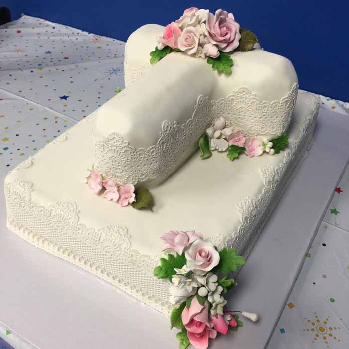 White and lace cake with pink flowers