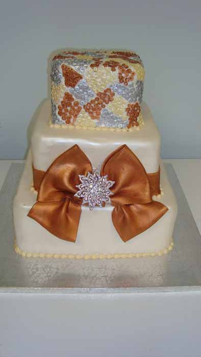 3 tiered cake with brown bow