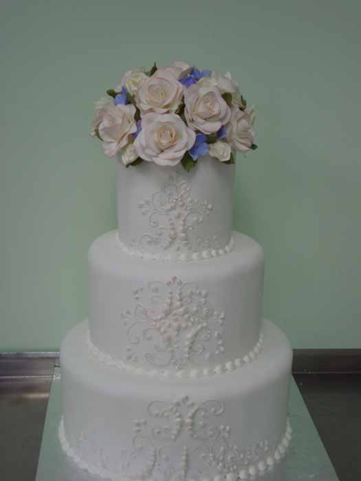 3 tiered white cake with flowers on top