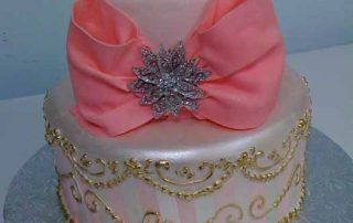 two tiered cake with pink bow