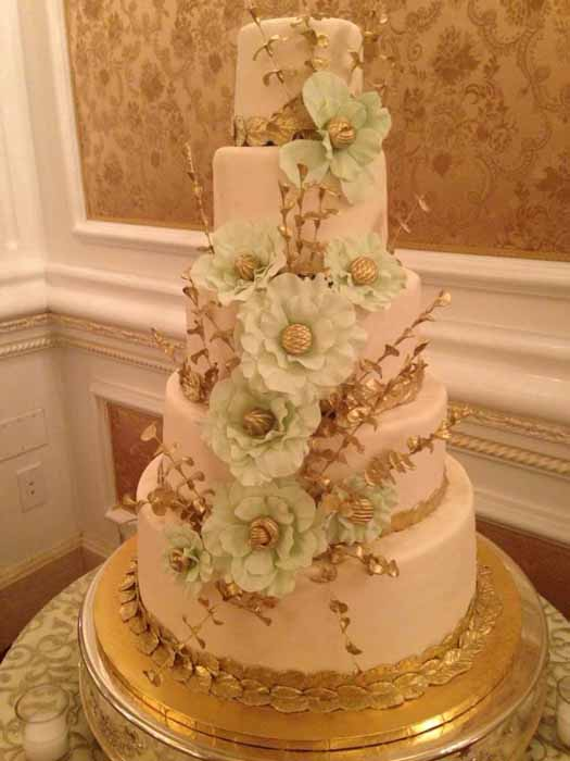 5 tiered cake with light green flowers