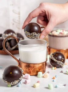 Dropping a Hot Chocolate Bomb in milk